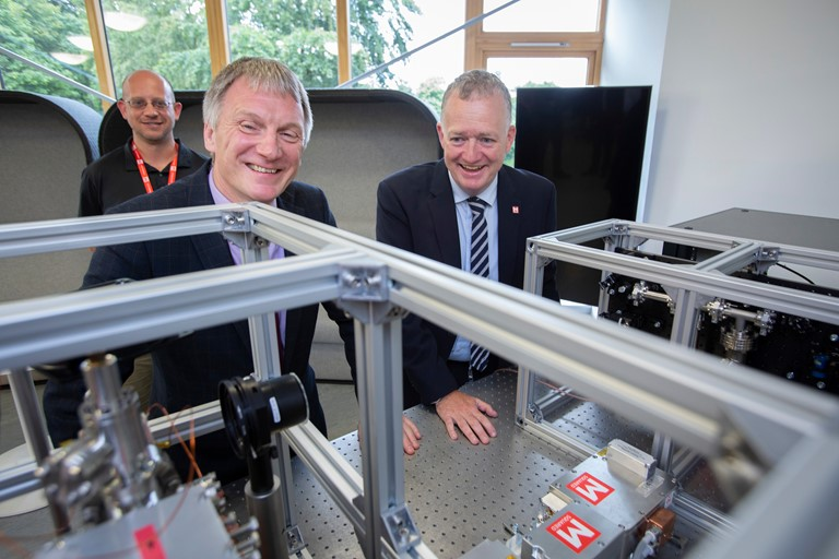 Inside a lab at M Squared Lasers - Pictured L-R  Quantum Technology Scientist Joshua Hughes , Trade & Investment Minister Ivan McKee with Dr Graeme Malcolm CEO and founder of M Squared